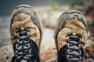 Brown and black leather hiking shoes. Photo by Tim Foster for Unsplash.