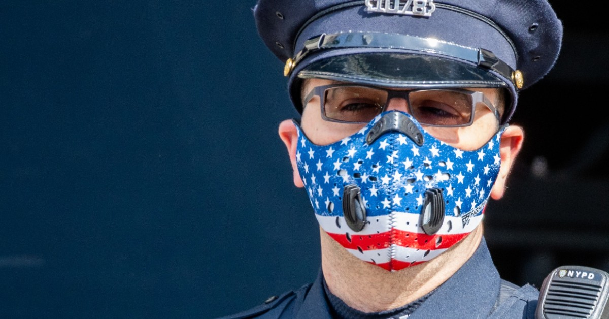 image of a new york police officer in uniform wearing an american flag face mask